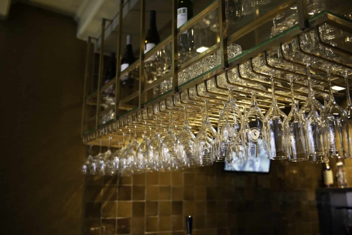 Glasses hanging above the bar